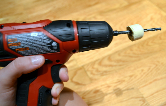 Drilling a hole through the cork will allow it to fit with the pump for the soap dispenser.