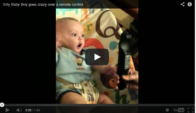Adorable baby goes crazy over a remote control.
