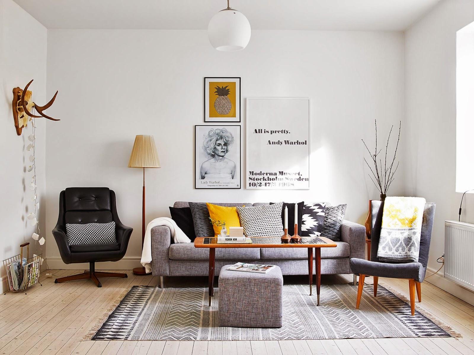 Kreativa kvadrat ab: en stilfull inredd lägenhet med vackert brädgolv