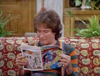 Robin Williams aka Mork reading Superman comic book