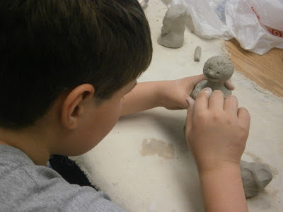 Student building clay warrior for terracotta warrior art lesson