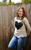 http://sisterswhat.blogspot.com/2013/11/heart-sweater-refashion.html