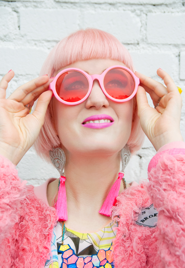 Iris Apfel glasses, pink tassels, lazy oaf jacket