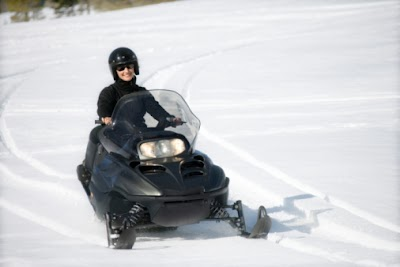 Snowmobiling over frozen lakes, rivers