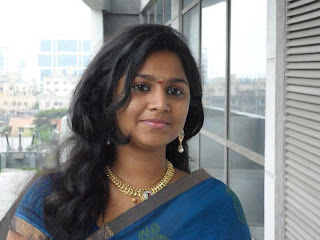 Homely tamil girl Madhu in saree and loose hair.