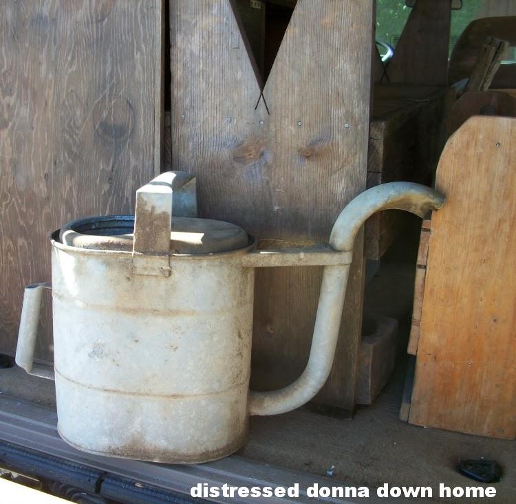 Vintage finds, vintage metal, watering can, garden urn, photographs
