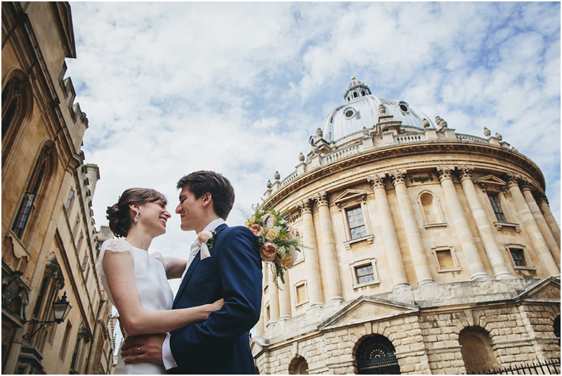 Bride and groom by Radcliffe Camera, Oxford