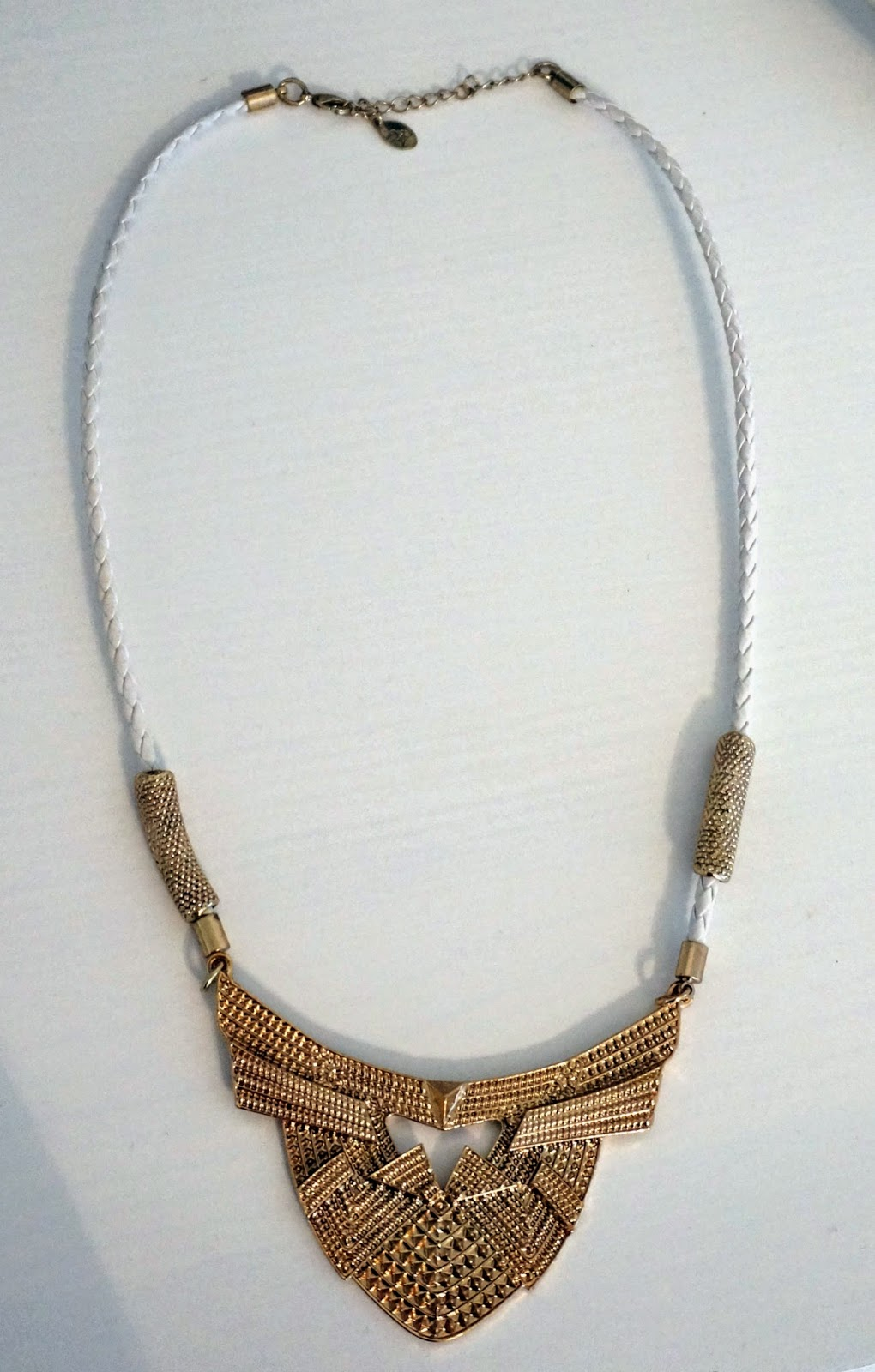 gold and white statement necklace