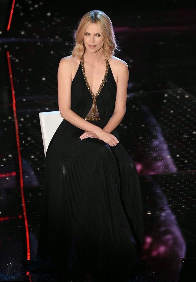 While Charlize Theron strolled properly in her dark gown, we have to give credit to her stately art for stealing the show.  And the 65th annual Sanremo Music Festival at Italy on Wednesday, February 11, 2015 were definitely a perfect destination to flaunting its all.
