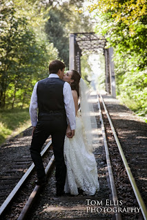 Thomas & Shaina kiss at the railway tracks - Kent Buttars, A Heavenly Ceremony