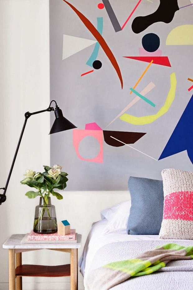colorful art work behind the bed