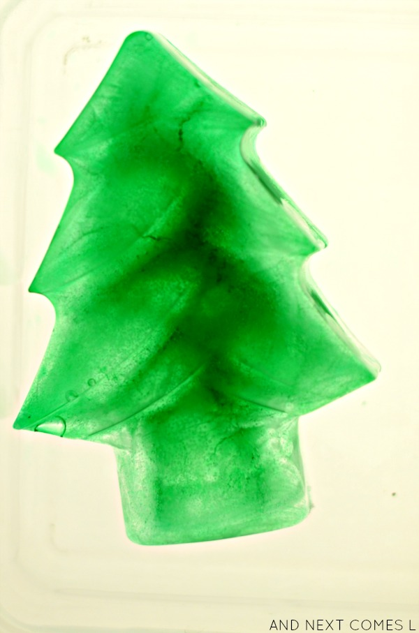Frozen Christmas tree on the light table - sensory science for toddlers and preschoolers from And Next Comes L