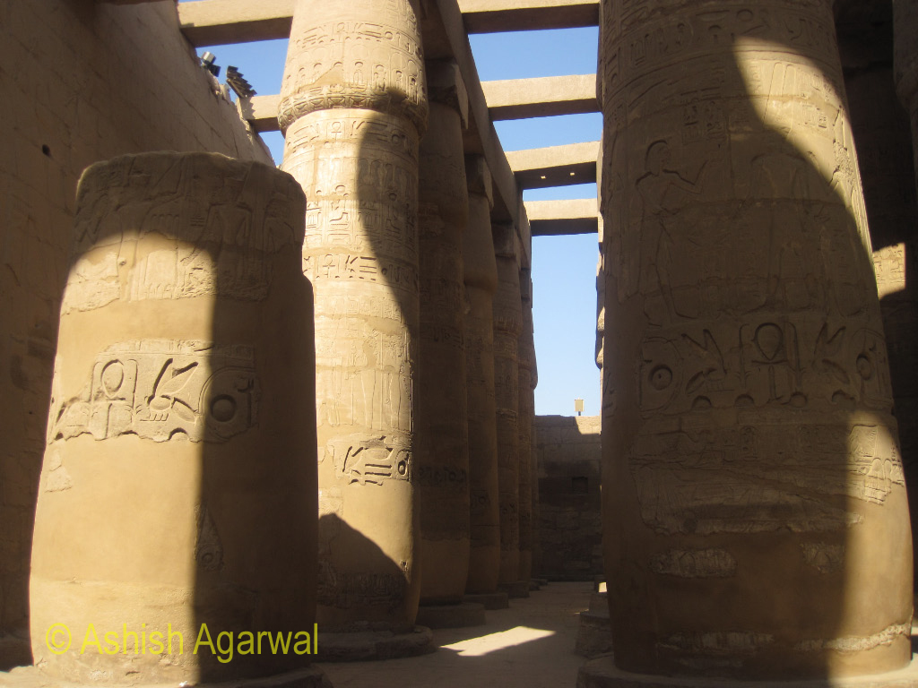 Carvings on multiple pillars inside the Karnak temple in Luxor