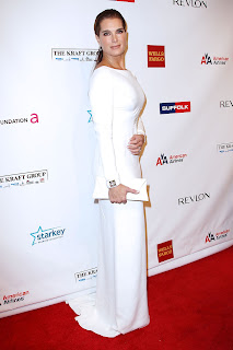 Brooke Shields looks glamorous in a white gown on the red carpet