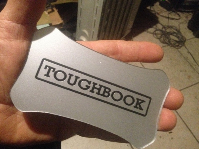 Laser-engraved Toughbook badge by Lee Maisel