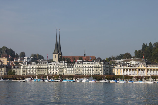 Jesuit Church and the high class National Hotel along Lake Lucerne in Lucerne, Switzerland