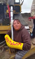 Lakota Woman and Native from Amazon lock down to pipeline machinery Tuesday