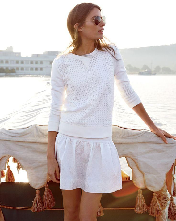 All white short skirt and sweater look so good near the sun setting seascape. Photo from the J.Crew June Style Guide