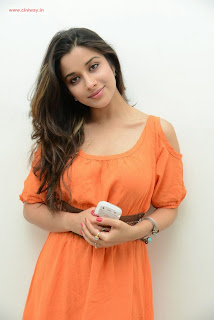 Madhurima-Stills-in-Orange-Dress
