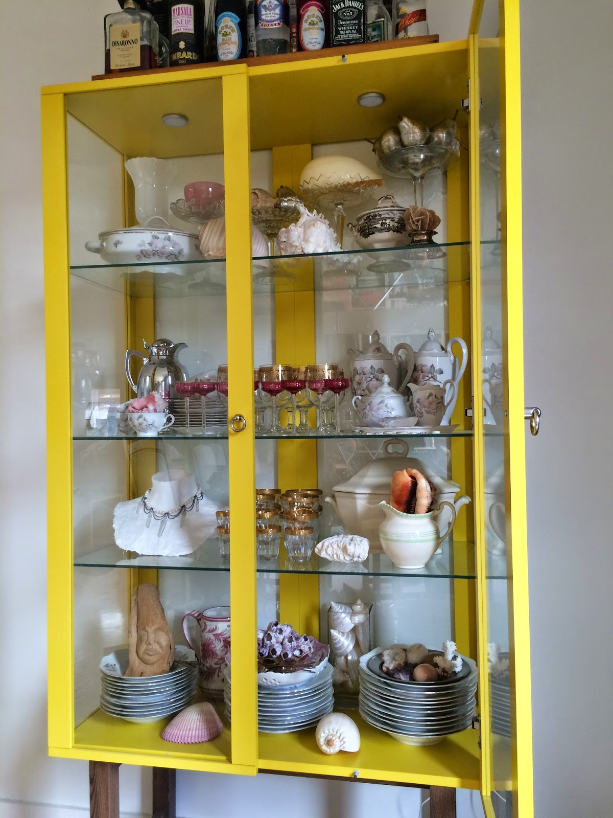 Kaffesoesters china cabinet will shells stones glass ware and inherited china