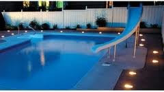 Pool accessories pool deck lighting ideas another way to do this is by drilling random inch wide holes in the decking clearing the resin and setting the lights beneath them mozeypictures Image collections