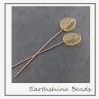 https://www.etsy.com/uk/listing/170661674/pair-of-handmade-lampwork-glass-leave?ref=shop_home_active