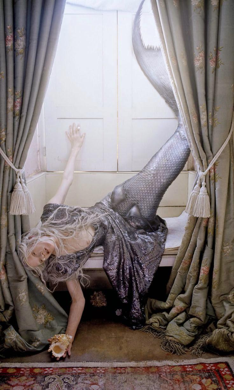 dead mermaid tangled in bedroom curtains