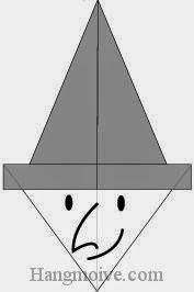 Bước 9:Vẽ mắt, mũi, miệng để hoàn thành cách xếp mặt phù thuỷ Halloween bằng giấy theo phong cách origami.