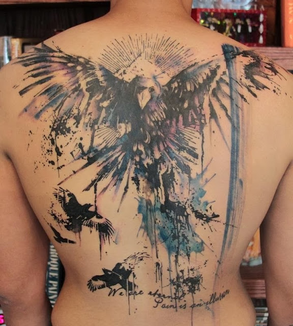 Horrible phoenix tattoo on full back body