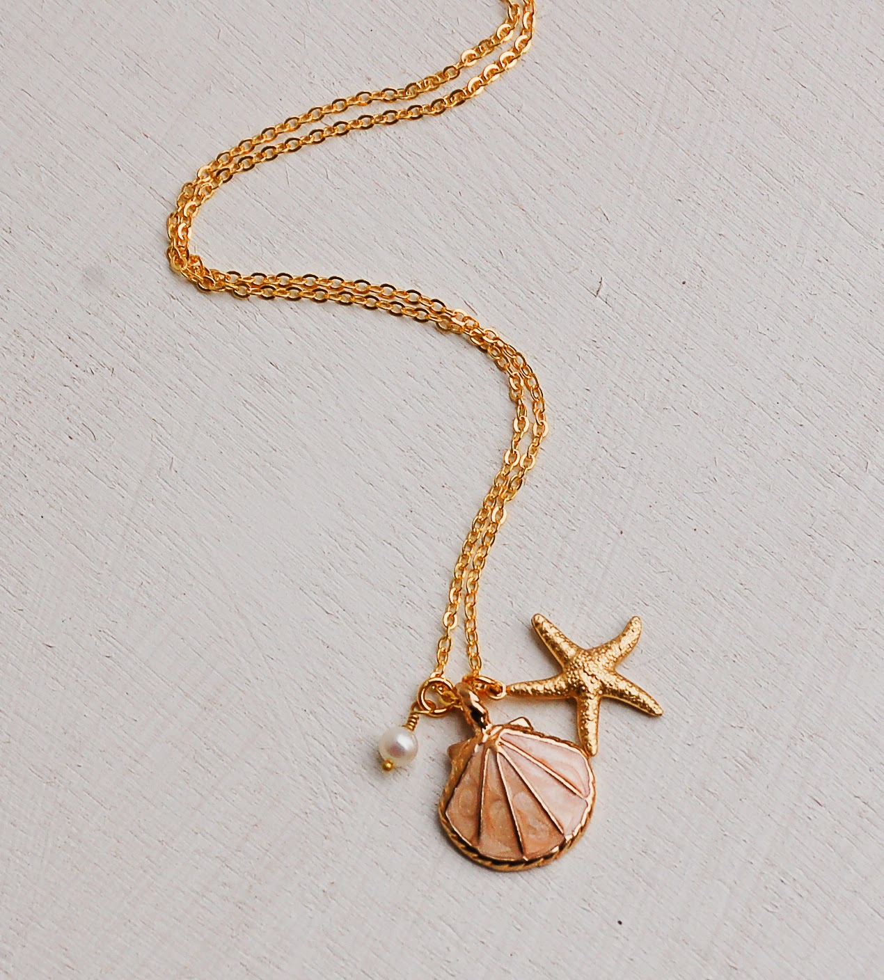 https://www.etsy.com/listing/223991572/sea-shell-necklace-gold-shell-necklace?ref=shop_home_active_1&ga_search_query=shell