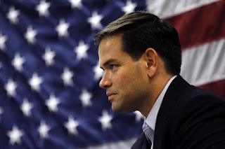 http://4.bp.blogspot.com/-4j30D1mgQ6E/TjdWIWhgr2I/AAAAAAAAAM0/lKbzPdKgIn0/s320/marco-rubio-flag-background.jpg