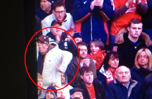 Liverpool fan caught making 'monkey' gesture