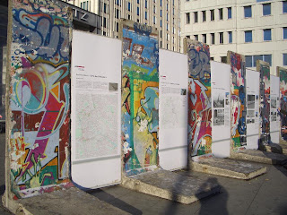 Berlin Wall Artwork and Graffiti and Political Cartoon Today