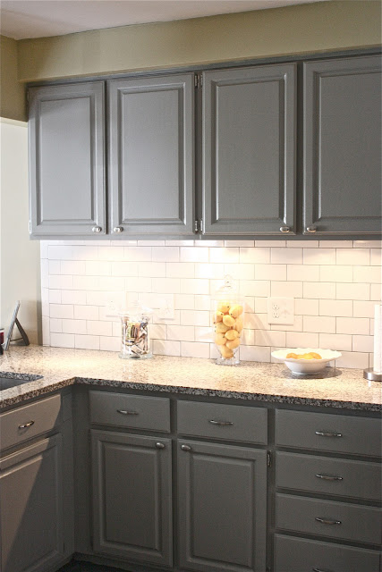 tile backsplash with dark gray grout, new lighting and accessories