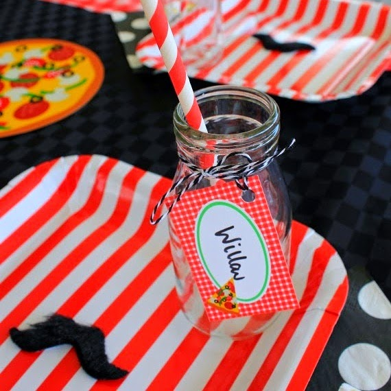 pizza party table for kids birthday with red and white striped plated red checked tablecloth stick on mustaches personalised tags decorated mil bottles bakers twine printable decorations