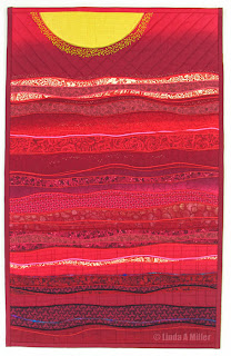 Pacifying Passion quilt in reds