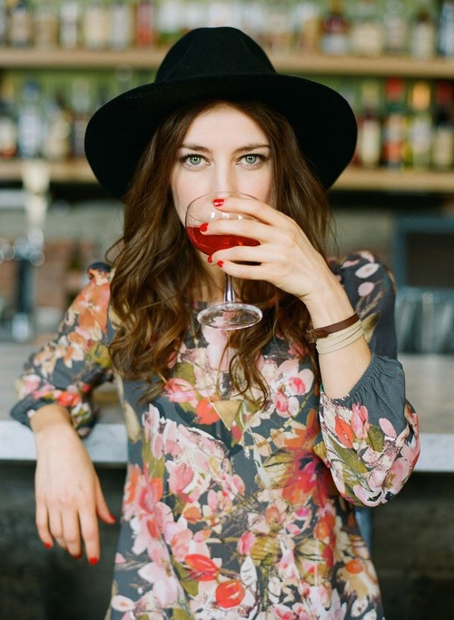 cool girl drinking a cup of red wine