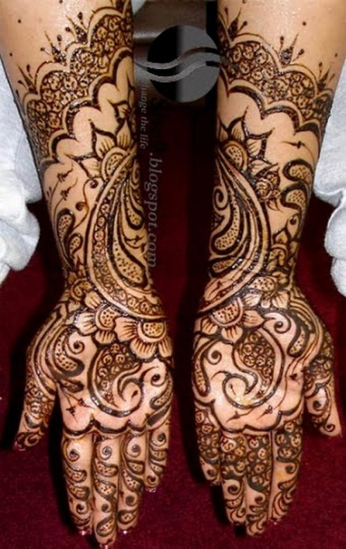 Indian Mehndi on the hands and feet