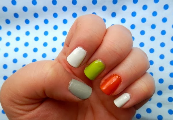 for the blood spatter design first paint a red stripe at the tip of the nail using a nail art brush or small dotting tool draw drips of red polish from