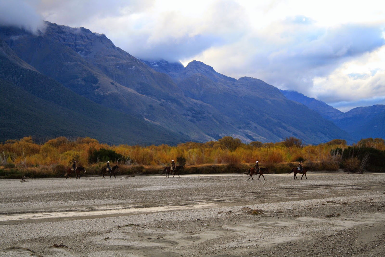 Horse riders in front of some mountains, near Glenorchy.