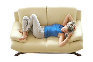 woman relaxing on clean upholstery
