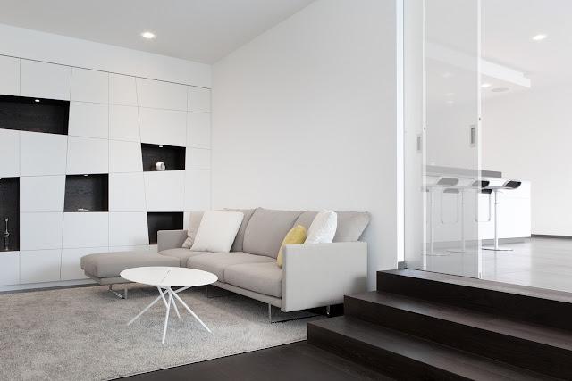 Grey sofa in sunken living room