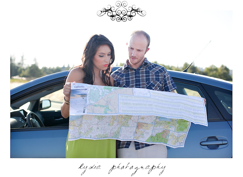 Lifestyle maternity portraits reading map at William Jessup University in Rocklin, California