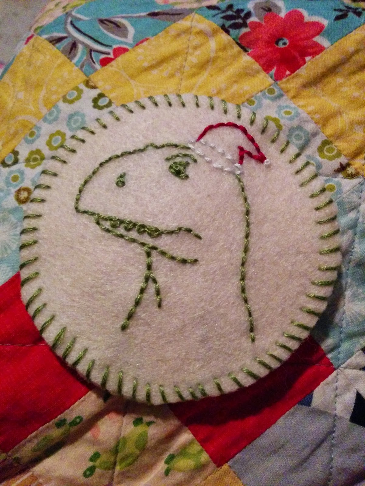 embroidered t-rex ornament
