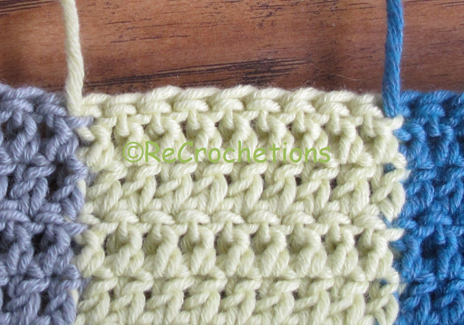 After working the first stitch in the new color, gently tighten the ...