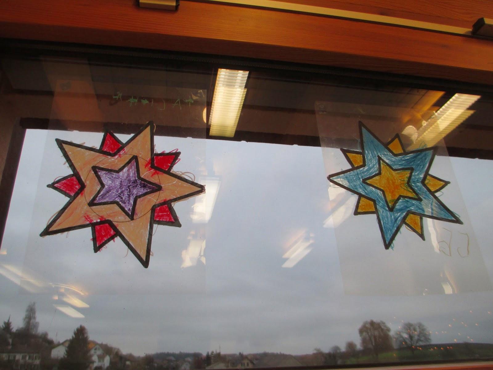Sterne an den Fenster mit Kindern malen