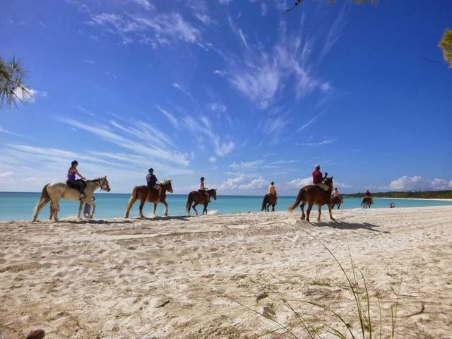 horseback riders on the beach at little san salvador