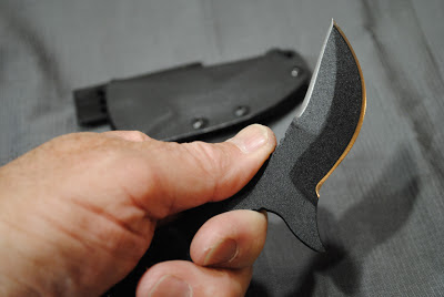 the normal grip put the thumb near the top blade.