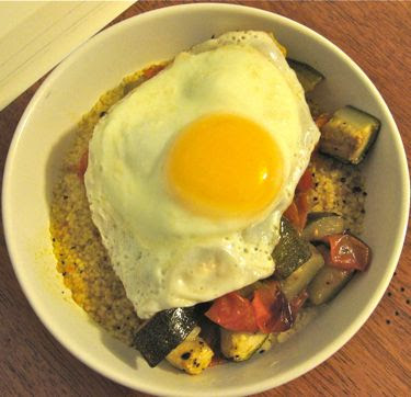 roasted sungold tomatoes and zucchini with couscous and fried egg