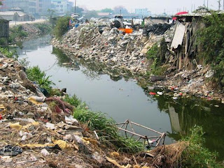 E-waste on the riverbank in Guiyu, China